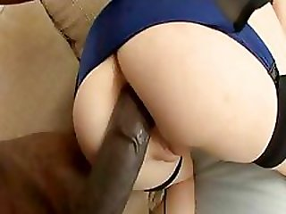 Hot blonde in glasses eats a big black cock and gets her ass nailed