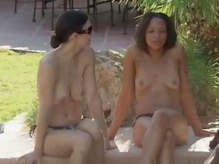 Lovely swingers playing outdoors