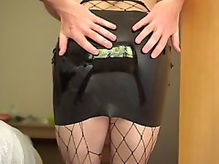 Spank In Latex Skirt