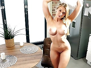 Blonde babe gets fucked to orgasm on the kitchen table