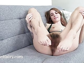Pearl Sage strips naked on her grey chair