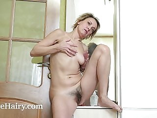 Ivanna masturbates after changing in her wardrobe
