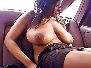 Big-breasted ebony flashed in car before a fuck